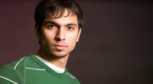 young latino in green shirt