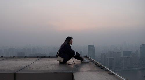 asian woman on a city rooftop